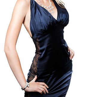 Slim woman wearing slinky evening wear and large necklace